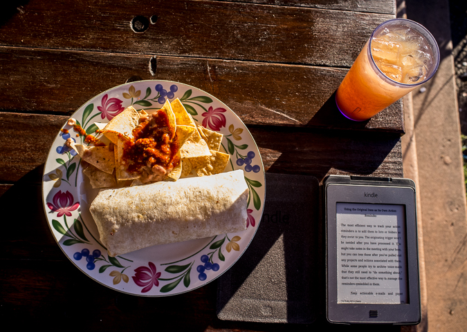 Enjoying a meal with my Kindle